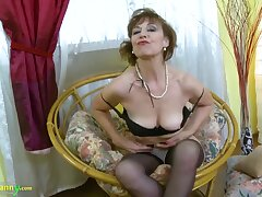 Mature lady is playing with her body slowly stripping adjacent to and exposing her natural curves