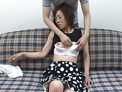 Horny Japanese mature gets undressed and pleasured in homemade video
