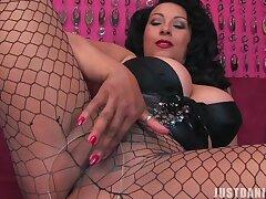 Seductive MILF Danica Collins fro fishnet stockings having solo fun