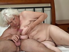 Marketable granny gets her pussy serviced by a young guy
