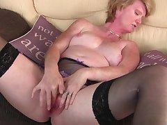 Short haired blonde mature MILF Sarah H. plays take a vibrator