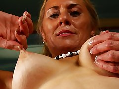 Amateur mature blonde Cristine Rubicund licks her tits and feet
