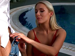 Glamorous blonde in overheated bikini Angelika Grays is making exalt by the poolside