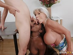 Busty mature loves assisting this ebony babe with the big dick