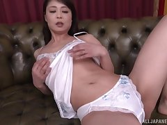 Mature Asian wife Ootomo Izumi stripping and masturbating overhead the sofa