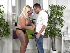 Mature blonde Anna Valentina drops on her knees to beg him hard