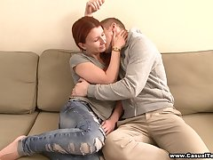 Amateur making love in the livingroom with charming redhead Inga