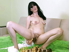 Evil Eva Masturbates thither a Chess Board