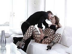 Sultry Ella Nova is wrapped in black fishnet during exceptional couch sex