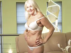 Sylvie is a smoking hot blonde who loves massaging her sopping pussy