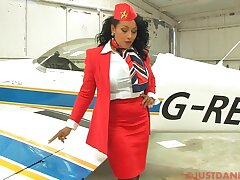 Busty stewardess Danica Collins takes off say no to panties to tease